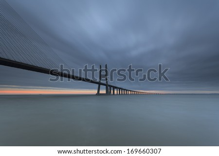 Dawn in the Vasco da Gama Bridge in Lisbon. - stock photo