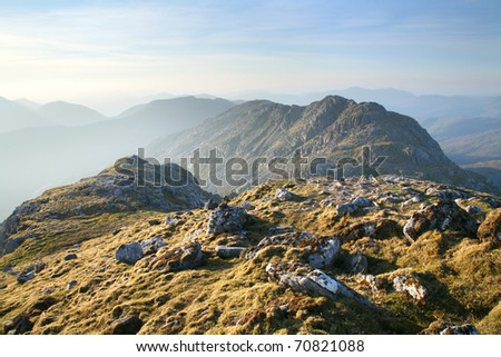 Dawn on a mountaintop on the Knoydart Peninsula, in the western Highlands of Scotland. - stock photo