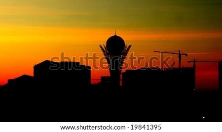 Dawn over modern cityscape - stock photo