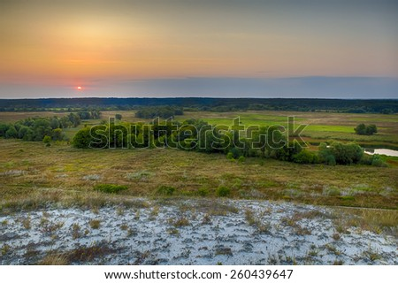Dawn over the steppe field - stock photo