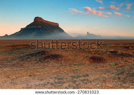 Dawn sky at Factory Butte, Utah, USA. - stock photo
