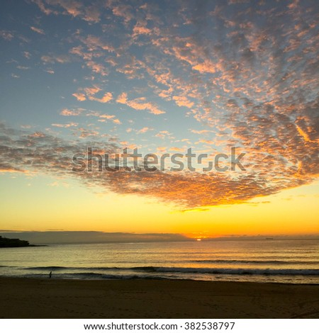 Dawn - Sun Rising over the Horizon with Magical Floating Clouds  (Sydney, Australia) - stock photo