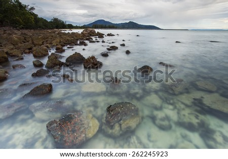 Dawn sunrise landscape over beautiful rocky coastline - stock photo