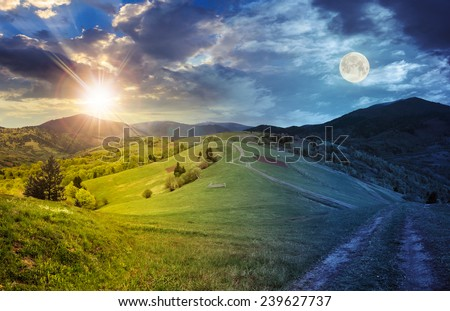 day and night collage landscape. fence near the meadow path on the hillside. village near forest in mountains with sun and full moon - stock photo