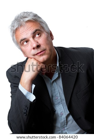 Day dreaming middle aged businessman, isolated image - stock photo