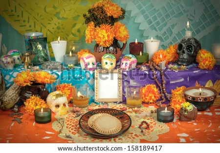 Day of the Dead Altar with sugar skulls and candles - stock photo