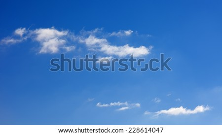 daytime blue sky with small white clouds - stock photo