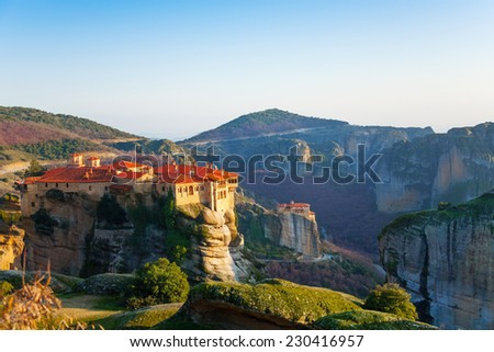 Daytime photo of a Holy Monastery of Great Meteoron with clear sky and amazing sunlight - stock photo
