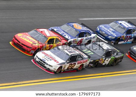 Daytona Beach, FL - Feb 22, 2014:  Regan Smith (7) holds off rest of the field to win the DRIVE4COPD 300 at Daytona International Speedway in Daytona Beach, FL. - stock photo