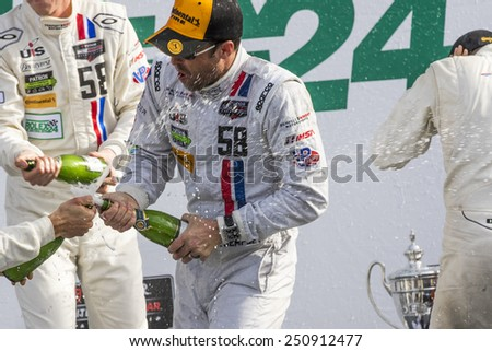 Daytona Beach, FL - Jan 25, 2015:  Patrick Dempsey (58) and his team celebrate after winning their division at the Rolex 24 at Daytona International Speedway in Daytona Beach, FL.  - stock photo