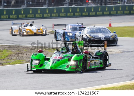 Daytona Beach, FL - Jan 24, 2014:  The Tudor United SportsCar Championship teams take to the track for a practice session for the Rolex 24 at Daytona International Speedway in Daytona Beach, FL. - stock photo