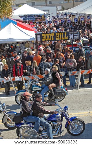 "DAYTONA BEACH, FL - MARCH 6:  Crowd of bikers at Boot Hill Saloon on Main Street during ""Bike Week 2010"" in Daytona Beach, Florida. - stock photo"