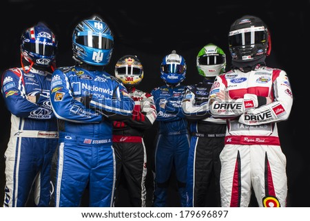 DAYTONA BEACH, NC - FEB 19, 2014:  Trevor Bayne, Ricky Stenhouse, Jr., Greg Biffle, Carl Edwards, Chris Boucher, Ryan Reed pose at the Daytona International Speedway in Daytona Beach, FL.   - stock photo