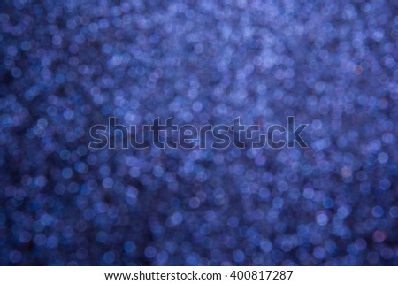 De-focused blue small lights seven-edged textured - de-focused abstract blue background - stock photo