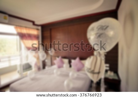 De focused/Blurred image of a Bedroom full of colorful balloons - stock photo