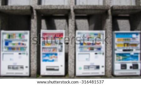 De focused/Blurred image of four vending machine between pillars. - stock photo