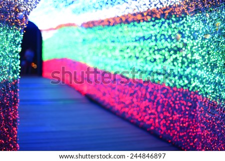 De-focused Christmas Light-colored walkway tunnel. - stock photo