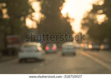 De focused or blurred cars on road in the evening background - stock photo
