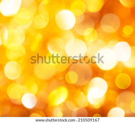 De focused Vintage golden shiny lights Christmas Bokeh background. - stock photo