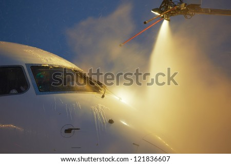 De-icing of the airplane - stock photo