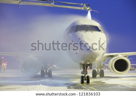 De-icing of the airplane, Vaclav Havel Airport Prague - stock photo