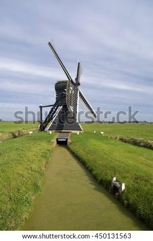 De Klaver (English: The Clover) or De Greate Klaver is a hollow post mill in Bolsward - stock photo