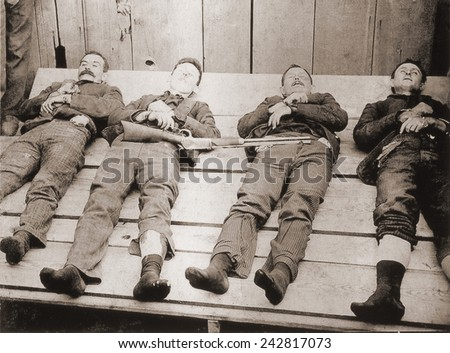 Dead bodies of four members of the Dalton Gang: Bill Powers, Bob Dalton, Grat Dalton and Dick Broadwell. They were killed after robbing banks in Coffeyville, Kansas on October 5, 1892. - stock photo