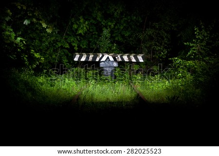 Dead end of the old abandoned railway line at night - stock photo