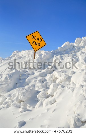 Dead End Sign in Snow Pile - stock photo