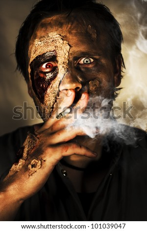 Dead Sexy Male Zombie Smoking On A Cigarette Cancer Stick With A Look Of Bloodshot Horror, Terror And Fear In A Killing Time Conceptual - stock photo