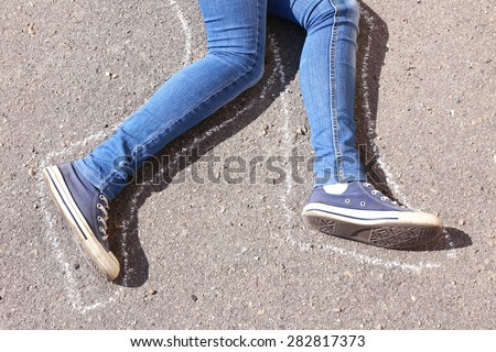 Dead woman laying on asphalt - stock photo