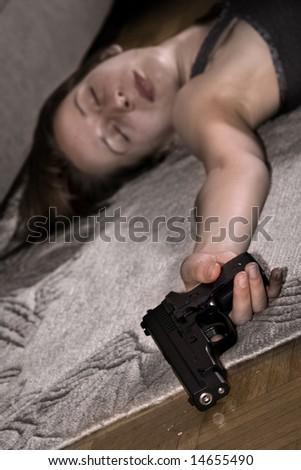 dead woman lying on the floor gun in the hand - stock photo