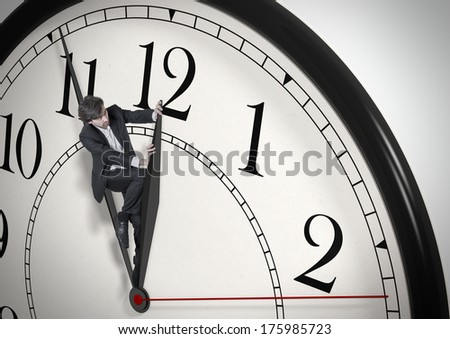 Deadline. Businessman trying to stop time. Time Management. Time pressure. Cure for old age. Perspective view. - stock photo