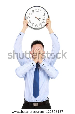 deadline concept of businessman with many hands holding clock and covering face isolated on white background - stock photo