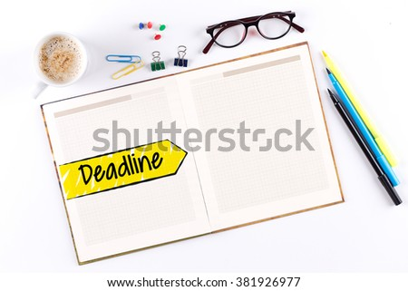 Deadline text on notebook with copy space - stock photo