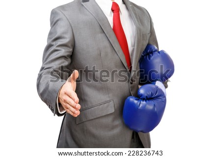 Deal ?!. Businessman with boxing gloves offering for a handshake isolated on white background - stock photo