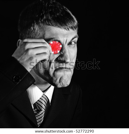 dealer, man with a red chip - monocular, on black - stock photo