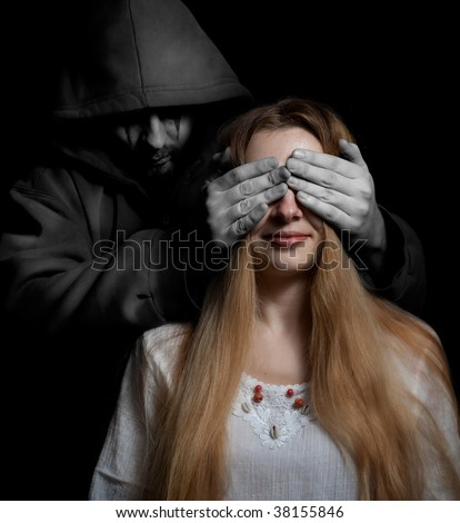 Death concept: woman surprised by evil sinister creature - stock photo