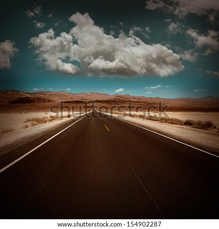 Death Valley straight road in desert National Park California California - stock photo