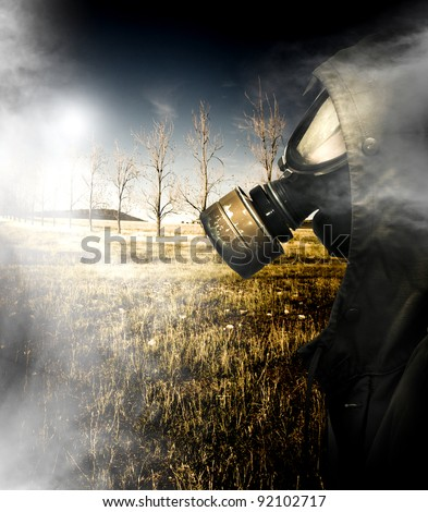 Death Wafting Through The Air Of A Dead Field With A Ukrainian Soldier In Millitary Issued Gas Mask Walking Past After A Nuclear Holocaust Terrorist Attack - stock photo