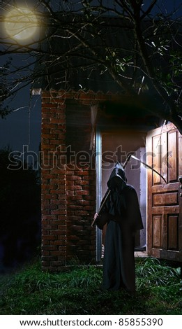 death with scythe is close to home - stock photo