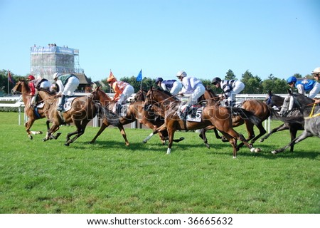 DEAUVILLE, FRANCE - AUGUST 25: horse races at the famous Deauville race track on August 25th, 2009 - stock photo