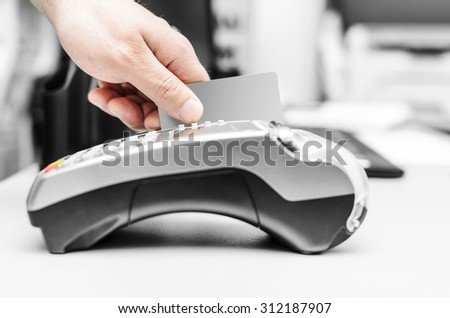 Debit card swiping on bank terminal. Business concept. - stock photo