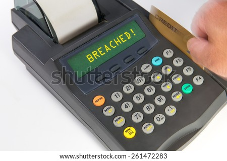 """Debit/Credit terminal showing a person actively swiping a card and getting a response of """"breached."""" Emphasis here is on the payment breaches occurring in the US and abroad. - stock photo"""