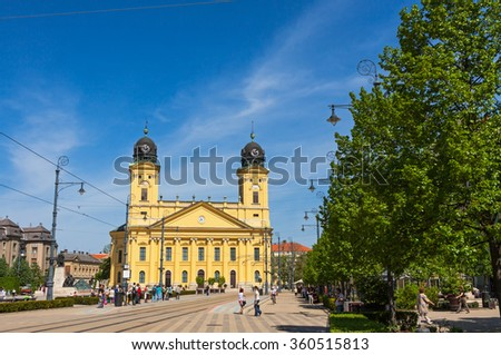 DEBRECEN, HUNGARY - APRIL 29, 2013: Kossuth square with Protestant Great Church (Hungarian: Reformatus Nagytemplom) on the background in Debrecen city, Hungary - stock photo