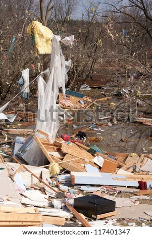 Debris from a home heavily damaged by an F2 tornado that swept through Oregon Twp in Lapeer County, MI on March 15, 2012. This photo was taken the next day. - stock photo
