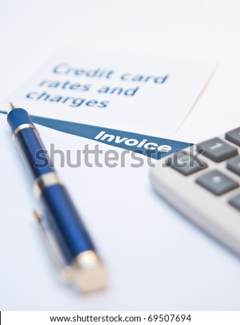 Debt situation with credit rates, invoice and calculator - stock photo