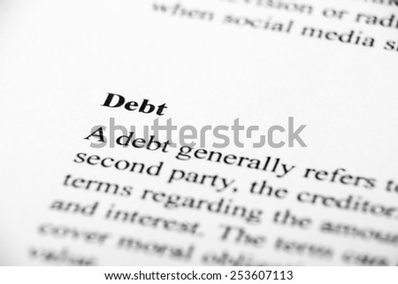 Debt with some other related words on paper. - stock photo