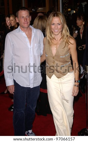 Dec 16, 2004; Los Angeles, CA: Singer SHERYL CROW & cyclist LANCE ARMSTRONG at the Los Angeles premiere of Meet the Fockers. - stock photo