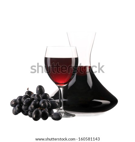 Decanter and glass with red wine and ripe grape - stock photo